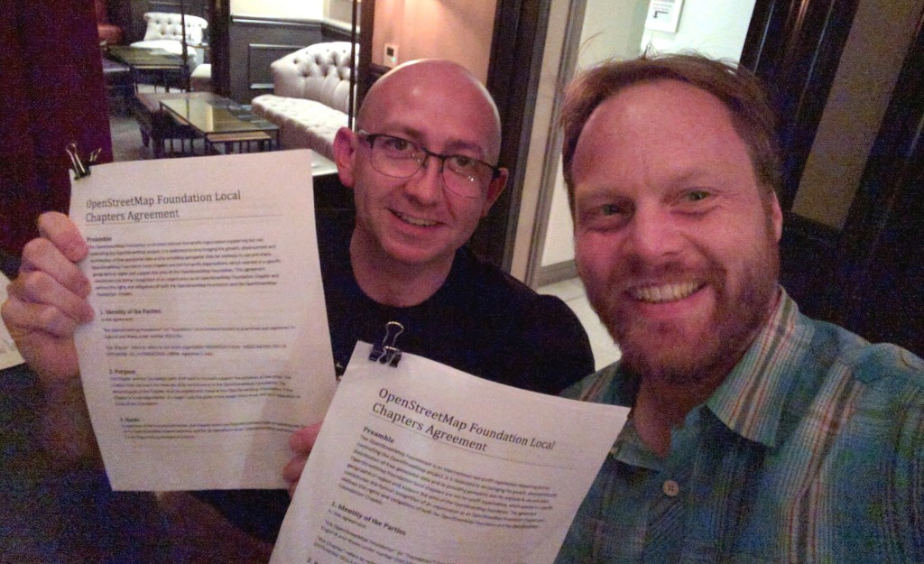 Simone Cortesi of OpenStreetMap Italia (left) and Martijn van Exel OSMF board (right), signing the local chapter agreement